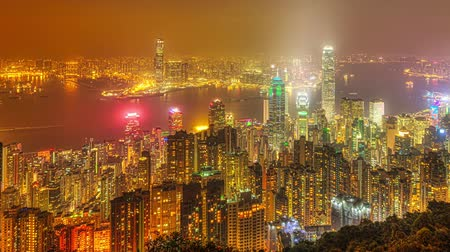 gözlem : Hong Kong night panorama wide view of Victoria Harbour skyline from Victoria Peak. The Peak is the highest mountain in Hong Kong Island of China.