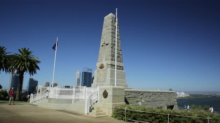 australian landscape : Perth, Australia - Jan 3, 2018: State War Memorial on Mount Eliza in Kings Park. Perth cityscape on background. Kings Park is a large park in Perth by Western Australian Botanic Garden. Blue sky.
