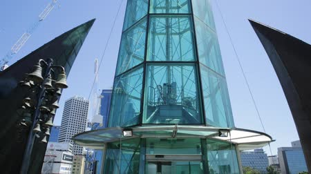 stained glass : Perth, Western Australia - Jan 3, 2018: bottom view of iconic glassed tower and tall skyscrapers of Elisabeth Quay in the blue sky. Architecture background. Landmarks in Perth City, Western Australia.