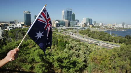 cbd : Australian flag waving over Perth Water, a section of Swan River, and central business district of Perth from Kings park, the most popular visitor destination in WA. Blue sky. Perth skyline aerial