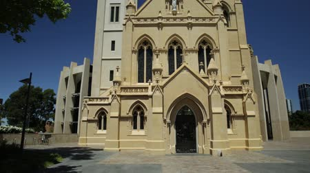 the conception : Front view of St Marys Cathedral in Perth, Western Australia. Cathedral of the Immaculate Conception of the Blessed Virgin Mary with sunny and blue sky. Stock Footage
