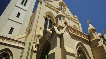 turistická atrakce : Facade of St Marys Cathedral in Perth, Western Australia. The Cathedral of the Immaculate Conception of the Blessed Virgin Mary in neogothic style is of Christian Catholic religion. Front view.