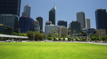 australian landscape : Perth, Western Australia - Jan 3, 2018: skyscrapers of Central Business District in Elizabeth Quay, Perth city. Australian summer destination. Sunny in a summer season. Blue sky and grass copy space.