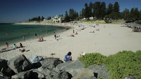 australian landscape : Cottesloe, Western Australia - Jan 2, 2018: white sand, calm turquoise waters for snorkeling at Cottesloe, Perths most famous beach, Indian Ocean. Cottesloe Surf Lifesaving Club on background