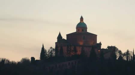 szentelt : close up of San Luca basilica church on Bologna hill, in a colorful sunset. blue hour in Italy