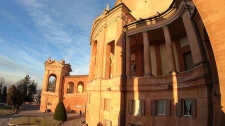 blessed virgin : Side view of facade of Sanctuary of Madonna di San Luca and arcades of its long portico with light of sunset. The church of Blessed Virgin of San Luca is a pilgrimage site.