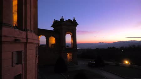 blessed virgin : Landscape of hills above Bologna from a window on the portico of San Luca Sanctuary with a scenic sunset light. Side view of arcades of the portico. Aerial view on the church courtyard.