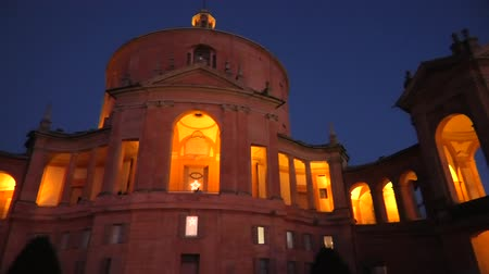 madona : Sanctuary of Madonna di San Luca basilica church illuminated at blue hour. Central facade of Cathedral of San Luca on the hills of Bologna, Emilia-Romagna, Italy. Famous landmark cityscape. Dostupné videozáznamy