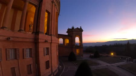 bologna : Courtyard of the Sanctuary of Madonna di San Luca illuminated at blue hour. Central facade of Basilica church of San Luca in Bologna, Emilia-Romagna, Italy. Famous landmark cityscape. Stock Footage