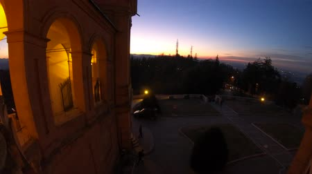 bem aventurança : Winter sunset on Sanctuary of Madonna di San Luca and arcades of its long archway with sunset light. The church of Blessed Virgin of San Luca is a pilgrimage site of Europe. Stock Footage