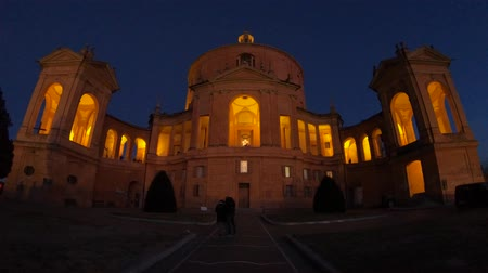 luke : Courtyard of Madonna di San Luca Sanctuary illuminated at night. Central facade of Basilica church of San Luca in Bologna, Emilia-Romagna, Italy. Famous landmark cityscape. Stock Footage