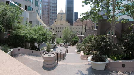 metropolitan area : Los Angeles, California, United States - August 9, 2018: Los Angeles Public Library from Bunker Hill Steps. The Library with a pyramid-shaped tower decorated with mosaics, is inspired by ancient Egypt Stock Footage
