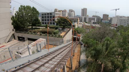 metropolitan area : Los Angeles, California, United States - August 9, 2018: perspective view of Angels Flight, a funicular railway in Hill Street, Bunker Hill of LA Downtown. Los Angeles Historic-Cultural Monument.
