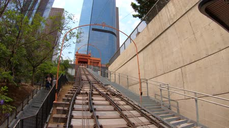 metropolitan area : Los Angeles, California, United States - August 9, 2018: POV view HYPER LAPSE on Angels Flight, a funicular railway in Hill Street, Bunker Hill of LA Downtown. Los Angeles Historic-Cultural Monument.