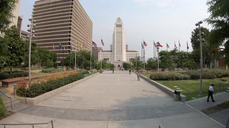 metropolitan area : Los Angeles, California, United States - August 9, 2018: Los Angeles City Hall and Civic Center buildings in Downtown of LA. The building is home to the government and mayor of city of Los Angeles. Stock Footage