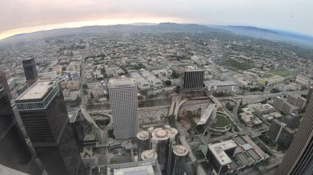 us bank tower : Los Angeles, United States - August 9, 2018:Aerial view of Los Angeles skyline at top view of Oue Skyspace with Hollywood Hills. Downtown of LA cityscape from observation deck on 70th floor. Stock Footage