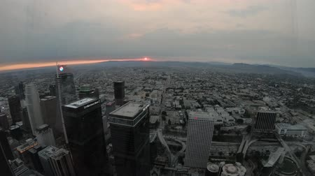 us bank tower : Los Angeles, United States - August 9, 2018:Aerial view at twilight of Los Angeles skyline with Hollywood Hills on background. Downtown of LA from observation deck on the 70th floor. Red colorful sky.