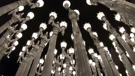 metropolitan area : Los Angeles, California, United States - August 9, 2018: Urban Light, sculpture at the entrance of Los Angeles Contemporary Art Museum, LACMA, composed of row street lamps. Black and white shot.