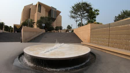 relics : Fountain at entrance of staircase leading to the Cathedral of Our Lady of the Angels in postmodern design. COLA or Los Angeles Cathedral in LA of Downtown, California, United States.