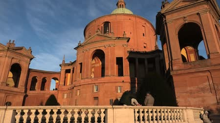 bem aventurança : Bologna, Italy - January 12, 2018: Entrance of Sanctuary of Madonna di San Luca in a sunny day with blue sky. Basilica church of San Luca in Bologna, Emilia-Romagna, Italy. Famous landmark cityscape.