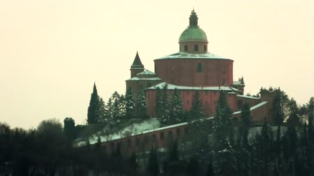 bologna : close up of San Luca basilica church with snow on Bologna hill in Italy
