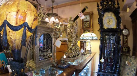 antiques : Solvang, California, United States - August 10, 2018: interior of Renaissance Antiques in Danish Village, one of finest antique galleries: vintage jewelry, restored clocks, music boxes.