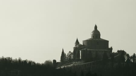 madona : historical black and white San Luca Sanctuary in Bologna city. Historical church and pilgrimage destination in Emilia-Romagna, Italy.