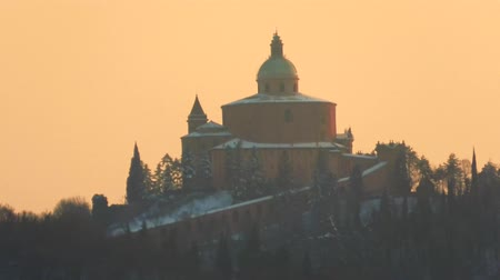 madona : San Luca basilica church at sunset with snow in winter on Bologna hill in Italy