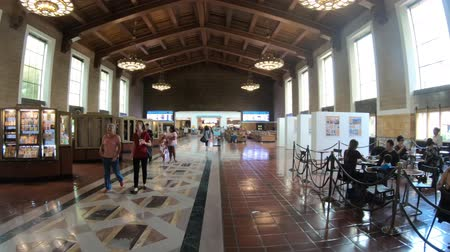commute : Los Angeles, California, United States - August 9, 2018: people and commuters inside main hall with painted ceiling in Union Train Station, El Pueblo Los Angeles Downtown, historic district.