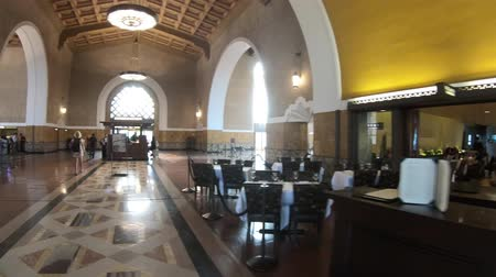 el train : Los Angeles, California, United States - August 9, 2018: information at hall with painted ceiling inside Union Train Station in El Pueblo Los Angeles Downtown, historic district.