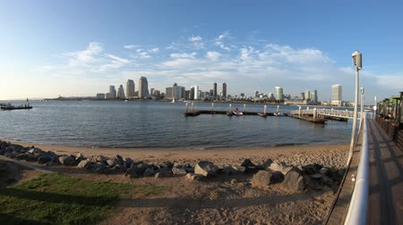 San Diego, California, United States - August 1, 2018: wooden footpath walkway along Bayside Village Pizzeria with covered patio in Coronado Island with views of downtown San Diego skyline.