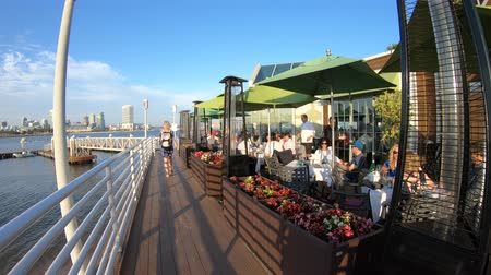 San Diego, California, United States - August 1, 2018: footpath walkway along Bayside Village Pizzeria with covered patio in Coronado Island with views of downtown San Diego cityscape.