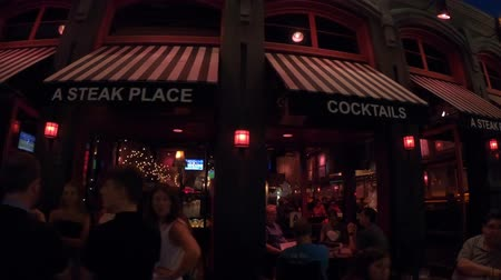 eatery : San Diego, California, United States - July 31, 2018: Gaslamp night club and steakhouse on Fifth Avenue, the main street of Gaslamp Quarter, Historic San Diego District. Street view by night.