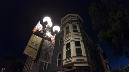 victorian : San Diego, California, United States - July 31, 2018: Typical vintage gas lamp with american flags, symbol of historic victorian Gaslamp Quarter, in San Diego Downtown. Streetlight against night sky.