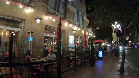 toscana : San Diego, California, United States - July 31, 2018: Toscana Cafe and Wine Bar restaurant on Fifth Avenue, the main street of Gaslamp Quarter, Historic District of San Diego Downtown by night. Stock Footage