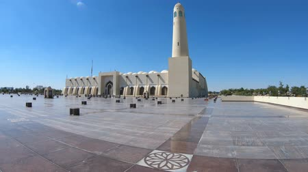 mosque doha : State Grand Mosque with a minaret reflecting on marble pavement outdoors. Doha mosque in Downtown, Qatar, Middle East, Arabian Peninsula. Morning daylight shot. Sunny day with blue sky.