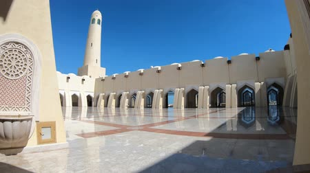 grand mosque : Doha, Qatar - February 21, 2019: panoramic courtyard with minaret and domes reflecting. Imam Abdul Wahhab Mosque or Qatar State Mosque in Middle East. The Grand Mosque is in West Bay.