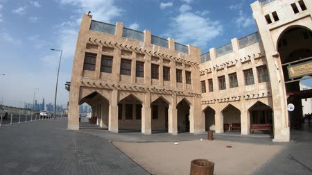 sas : Doha, Qatar - February 18, 2019: facade of historic Falcon Souq entrance near Souq Waqif, a market selling live falcon birds and falconry equipment located in the center of Doha. Sunny blue sky.