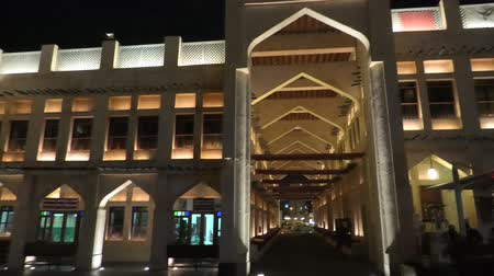 cetreria : Doha, Qatar - February 18, 2019: historic Falcon Souq, a market selling live falcon birds and falconry equipment located in the center of Doha by night. Night cityscape. Popular tourist attraction.