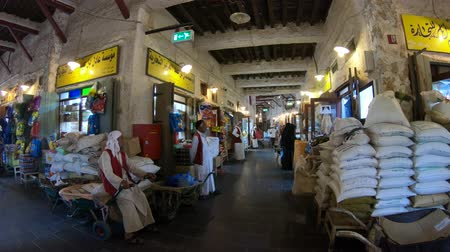 porters : Doha, Qatar - February 17, 2019: numerous goods to be loaded and porters with carts in the covered part of the traditional Souq Waqif during the day.