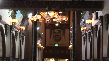 восточный базар : Doha, Qatar - February 17, 2019: Souq Waqif Art Center inside Souq Waqif, old traditional market. Picture of Tamim bin Hamad al-Thani the current Emir of Qatar.