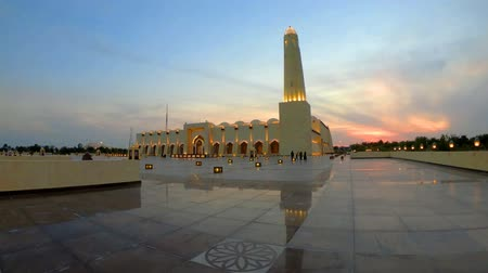 mosque doha : Scenic Doha Grand Mosque with a minaret at sunset light reflecting on the outdoor pavement. Qatar State Mosque, Middle East, Arabian Peninsula in Persian Gulf.