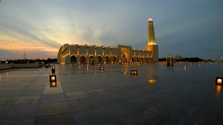 grand mosque : Wide angle view of State Grand Mosque with a minaret at twilight reflecting on marble pavement outdoors. Qatar State Mosque, Middle East, Arabian Peninsula in Persian Gulf. Famous touristic place.