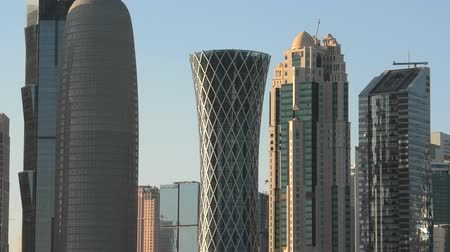 sheraton : Doha, Qatar - February 18, 2019:Scenic cityscape of Doha West Bay skyline at sunset light reflecting in the sea. Modern glassed skyscrapers of Doha skyline in Qatar. Arabian Peninsula in Persian Gulf.