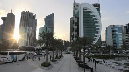 sheraton : Doha, Qatar - February 18, 2019: West Bay skyscrapers at sunset view from Sheraton Park in Doha Downtown. Modern towers of Doha skyline, Middle East, Arabian Peninsula in Persian Gulf. Stock Footage