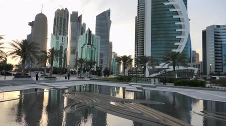 sheraton : Doha, Qatar - February 18, 2019:Scenary of Doha West Bay skyline at sunset reflecting in the water. Modern glassed skyscrapers of Doha skyline in Qatar, Middle East, Arabian Peninsula in Persian Gulf. Stock Footage