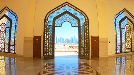 grand mosque : Doha, Qatar - February 21, 2019: decorated entrance door inside Imam Abdul Wahhab Mosque. Qatar State Mosque in arab style, Middle East, Arabian Peninsula. The Grand Mosque, West Bay. Vertical shot.