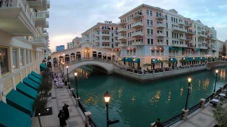 Doha, Qatar - February 20, 2019:Wide angle view of bridge in Venice at Qanat Quartier in the Pearl-Qatar, Persian Gulf, Middle East. Aerial view of luxurious district of Doha, Qatar in venetian style. Стоковые видеозаписи