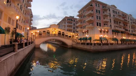 Doha, Qatar - February 20, 2019:Aerial view of Venetian bridges on canals with Rialto bridge replica in luxurious district of Doha at blue hour. Scenic Venice at Qanat Quartier in the Pearl-Qatar.