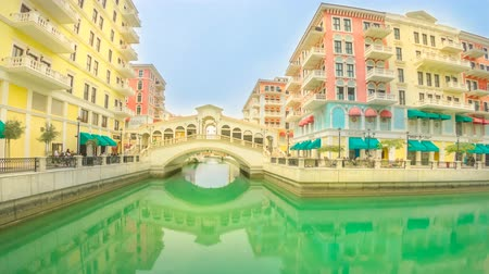 Doha, Qatar - February 20, 2019: TIME LAPSE view of Venice Rialto bridge replica at Qanat Quartier in the Pearl-Qatar, Persian Gulf, Middle East. Venetian bridge on canals Стоковые видеозаписи